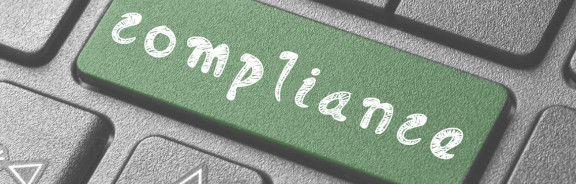 green-compliance-button-on-computer-keyboard
