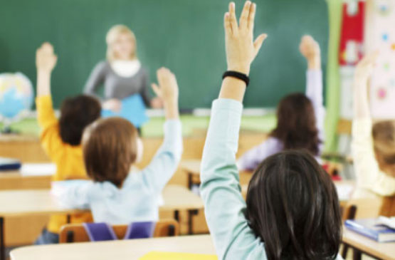 school-pupils-with-their-hands-up-in-class